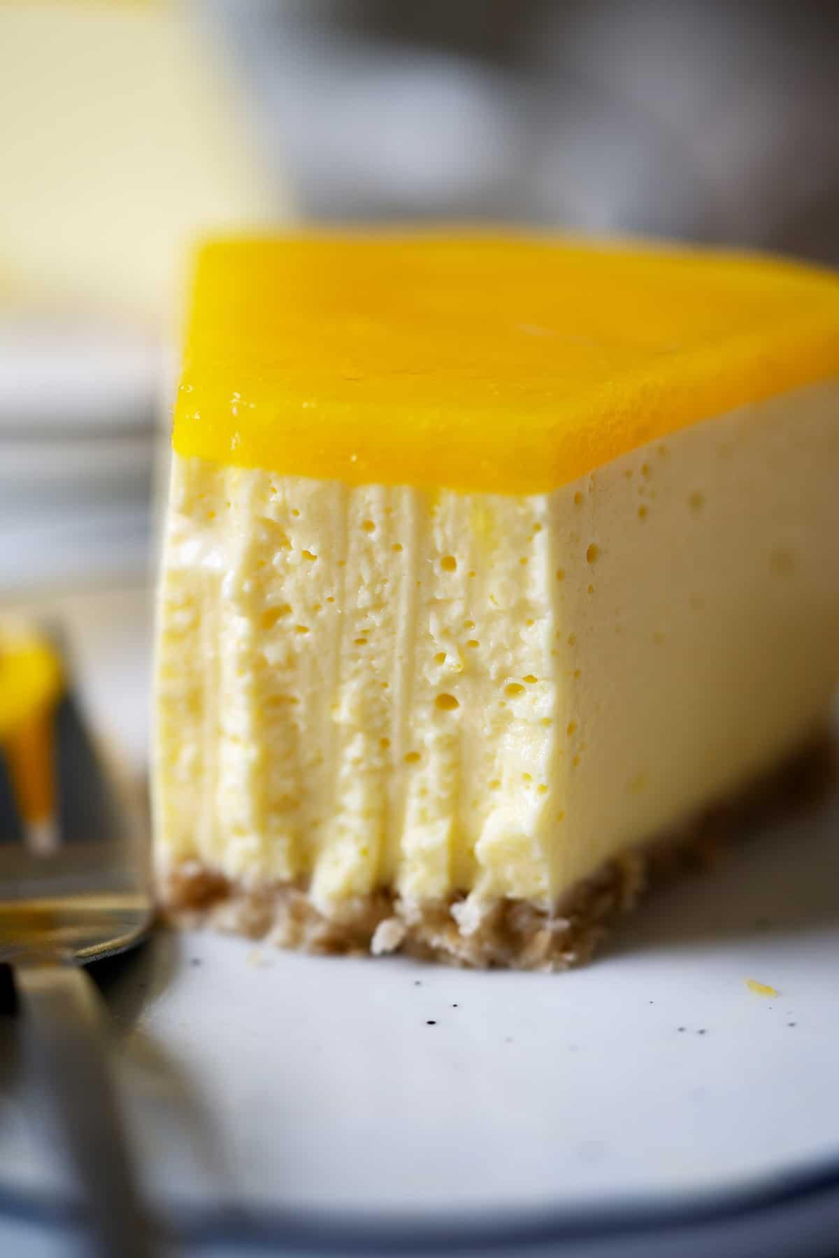 Half eaten of a slice of healthy no bake mango cheesecake