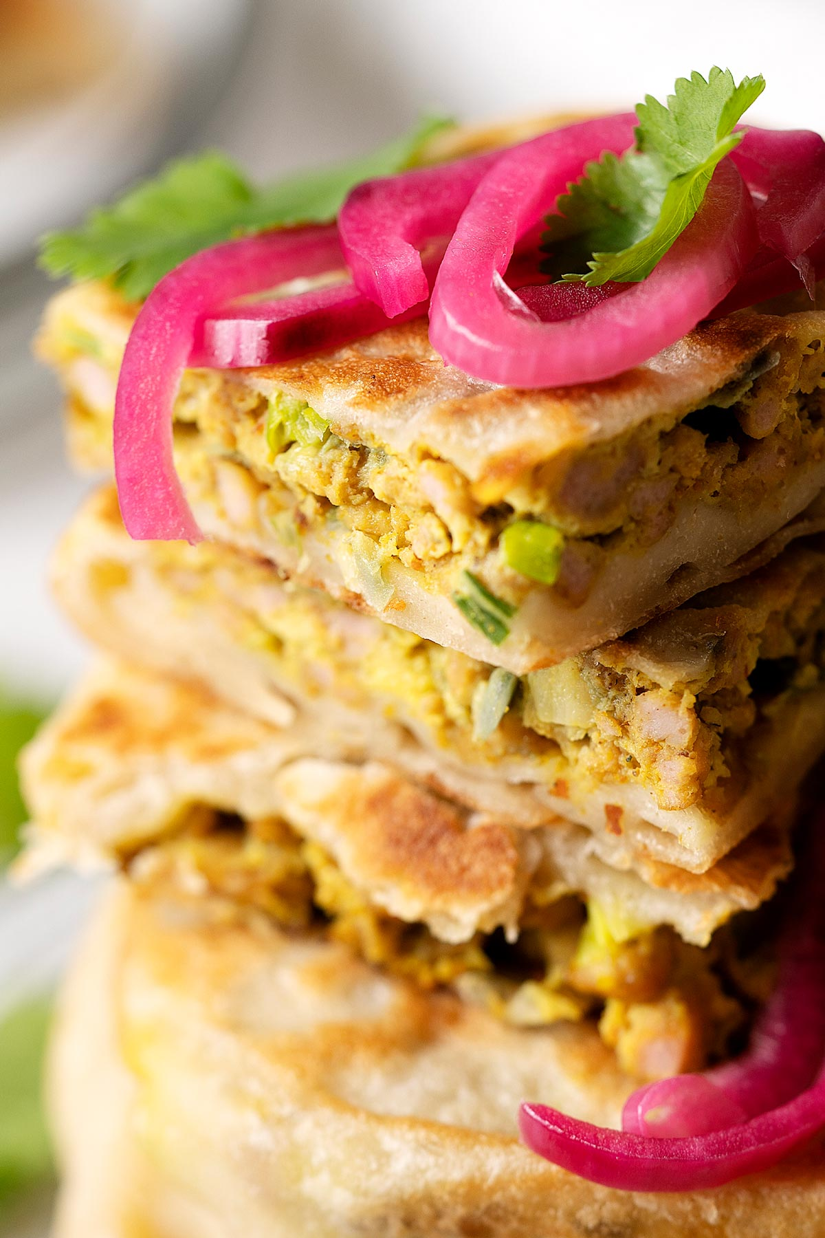 Close up showing the texture of a sliced chicken murtabak flatbread