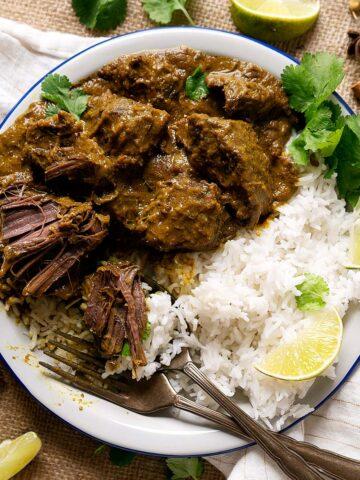 overhead view of half eaten beef rendang with rice.