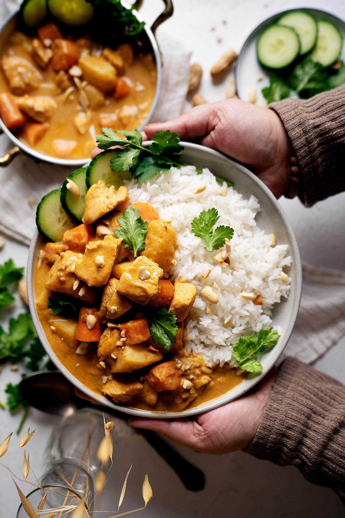 Holding a plate of quick chicken massaman curry