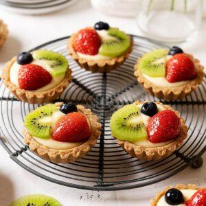 Healthier fruit tarts on a rack