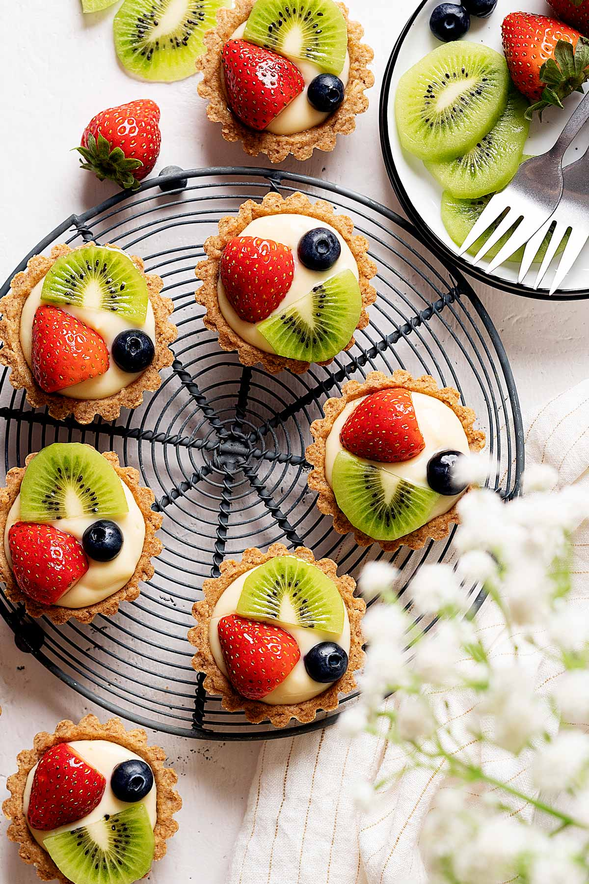 Healthier fruit tarts on a rack view from top