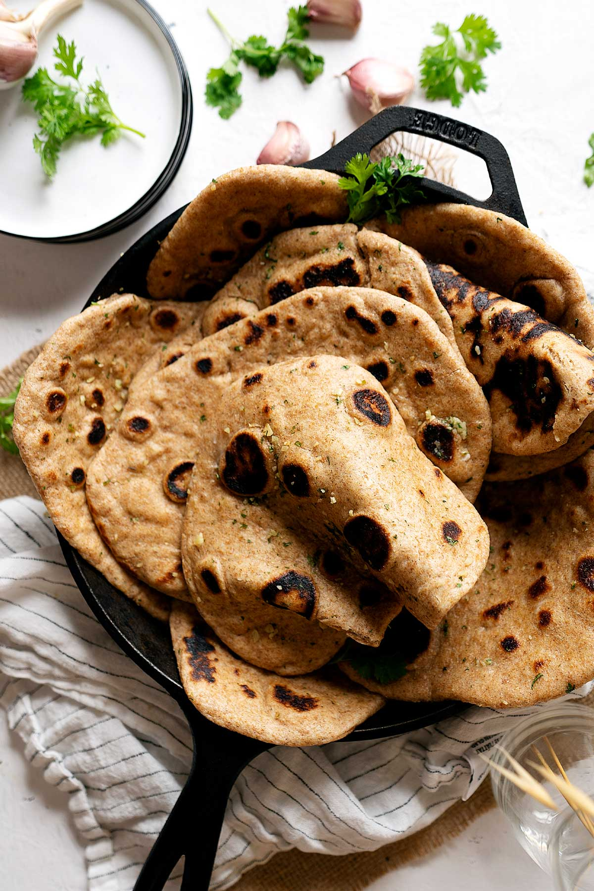 Whole wheat garlic naan in a skillet view from top