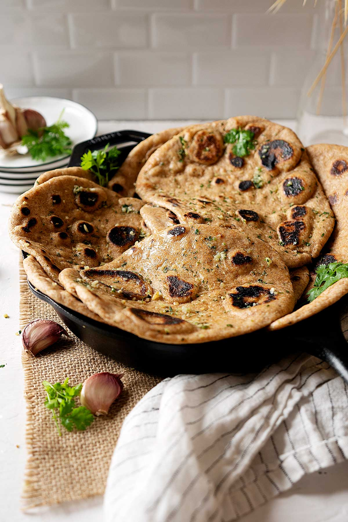 Whole wheat garlic naan in a skillet view from front