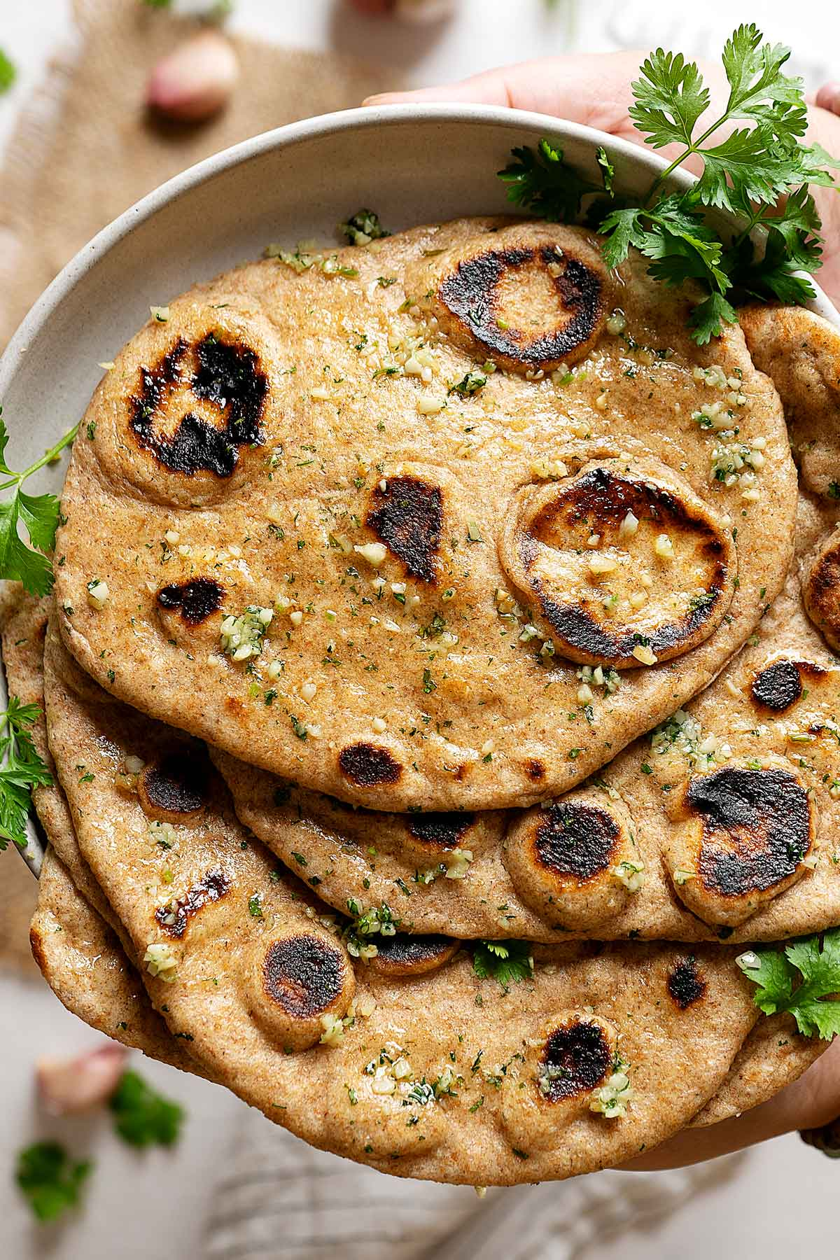 Close up of whole wheat garlic naan view from top