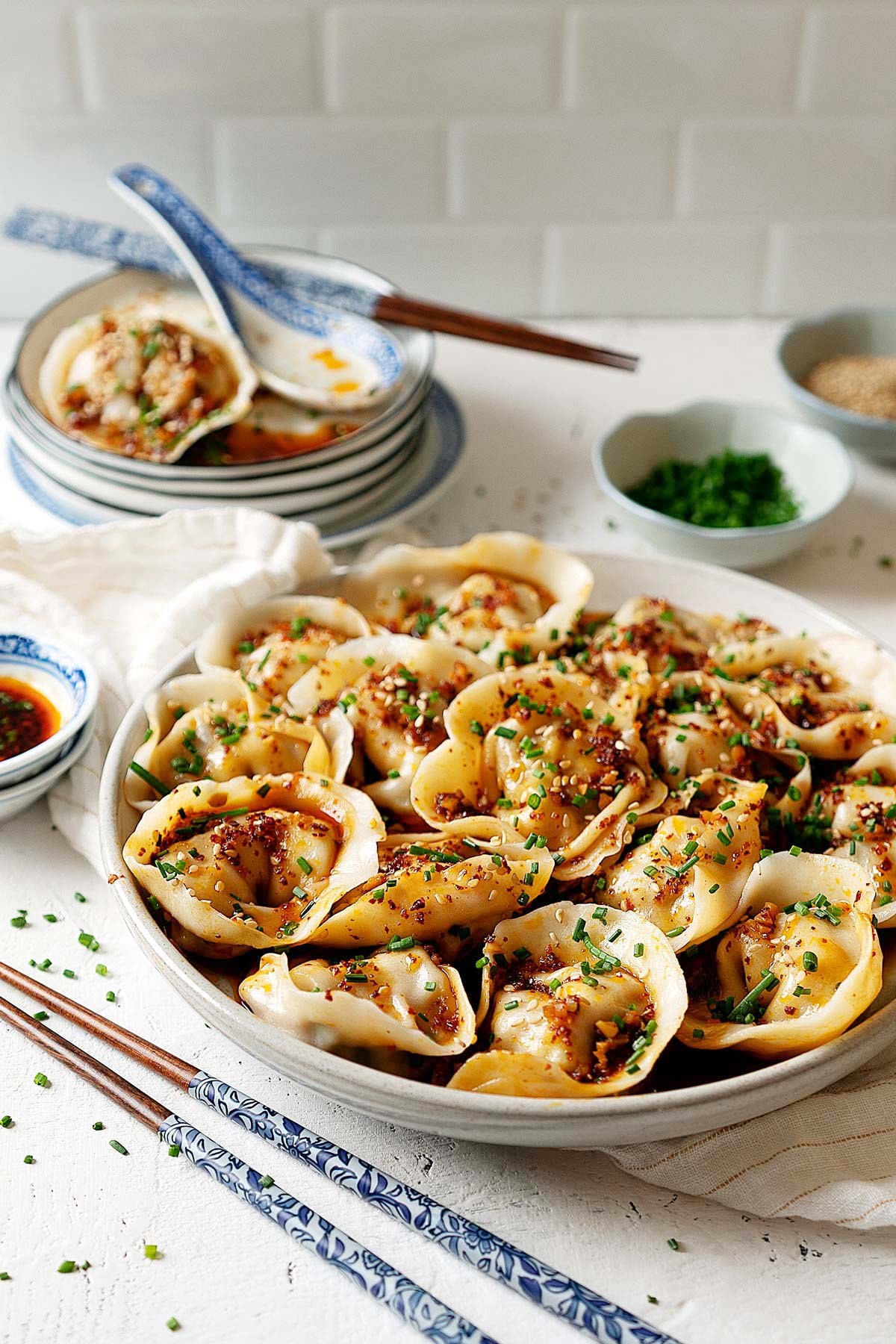 Wontons in garlic chili oil in a plate view from front