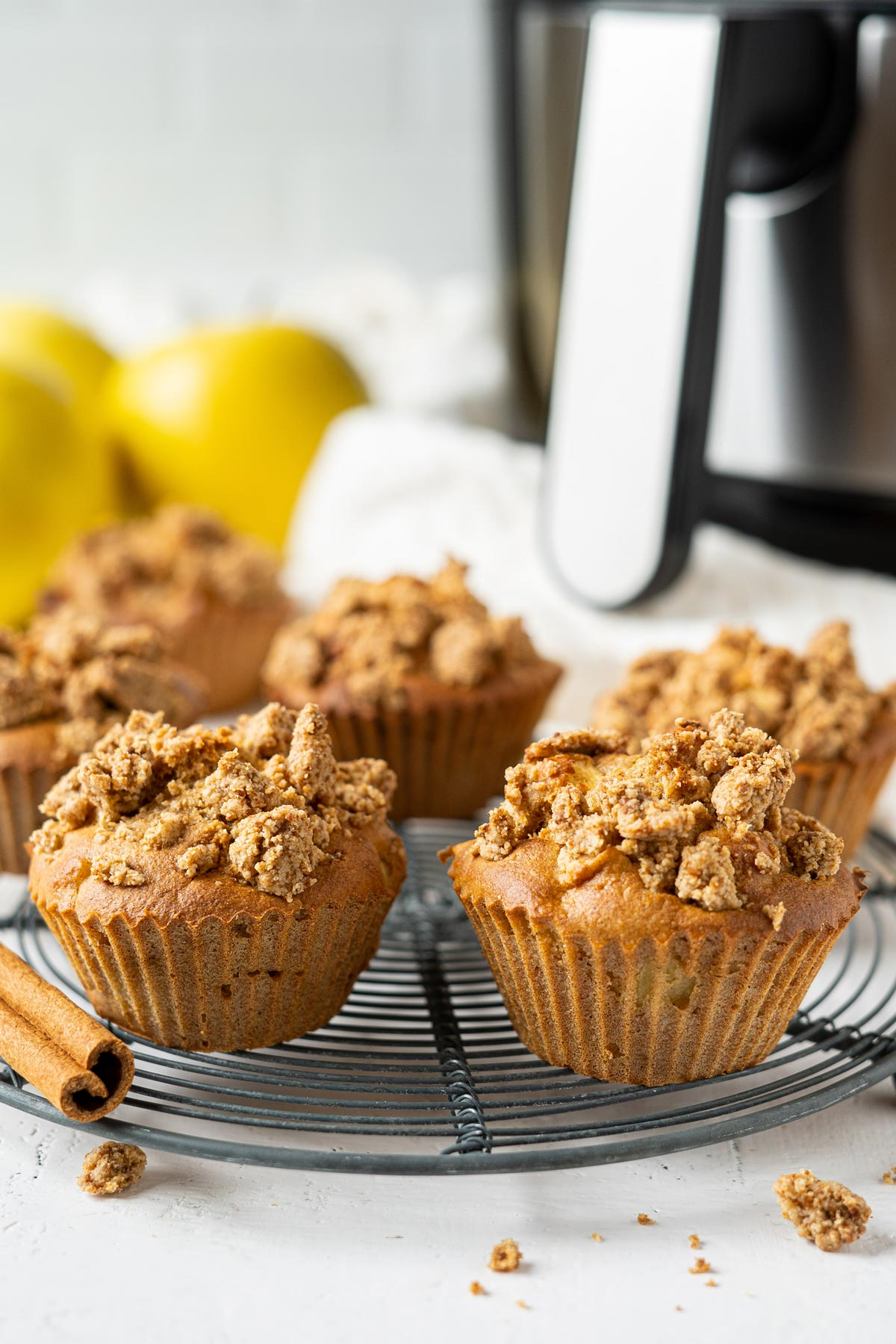 Air fryer apple crumble muffins on a rack