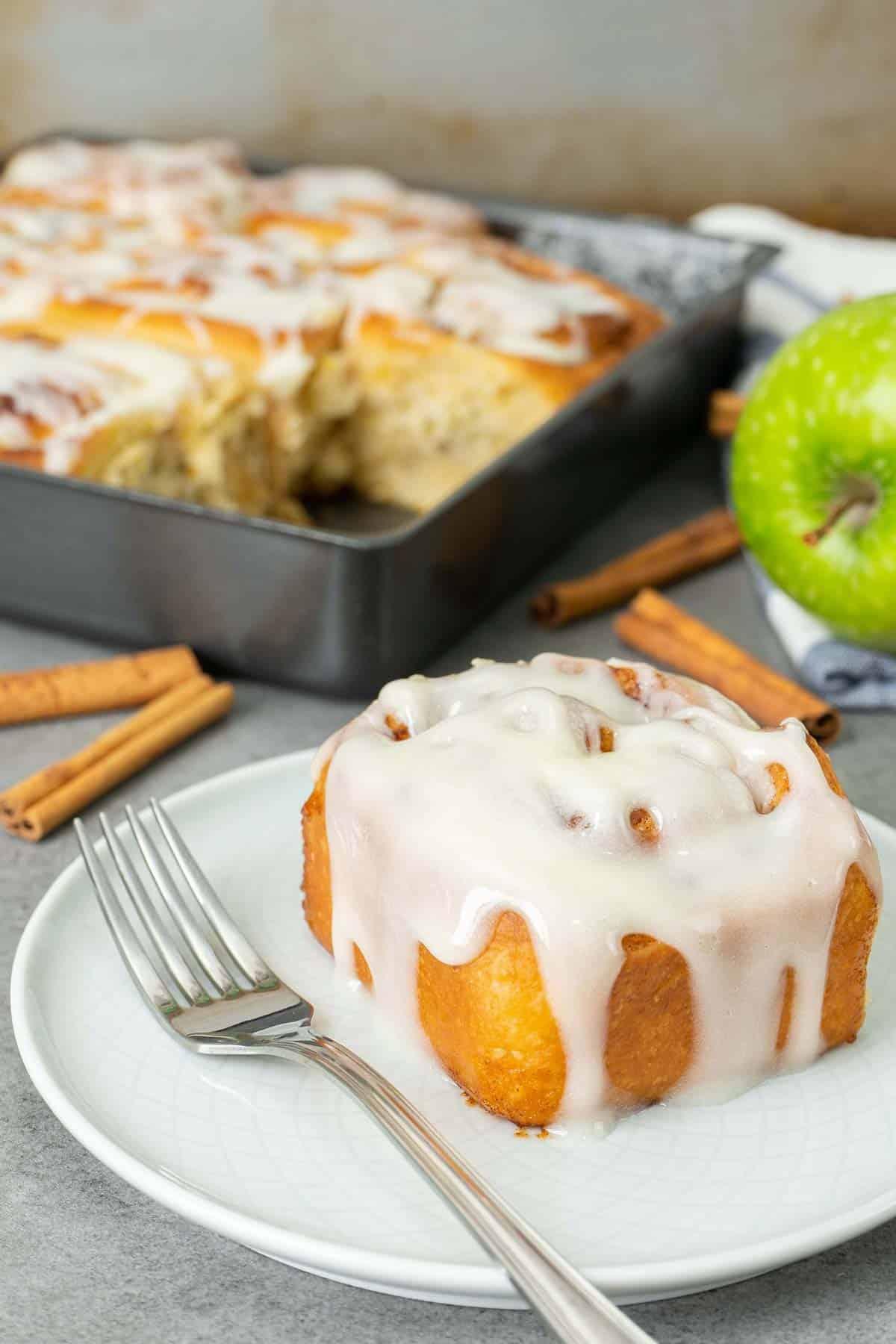 apple cinnamon roll served on a plate.