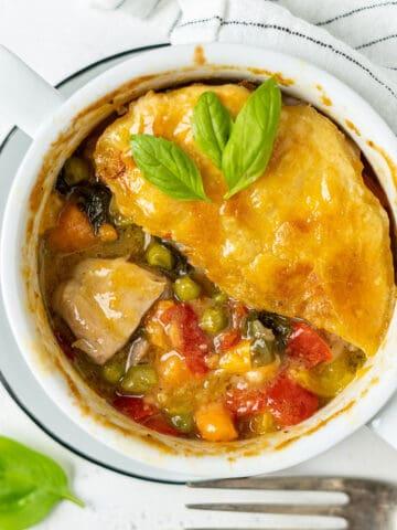 Half eaten basil chicken pot pie in a bowl